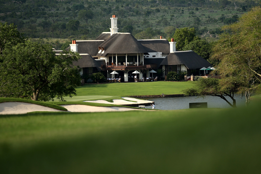 The iconic thatched clubhouse at Leopard Creek, with the magnificent Kruger National Park in the background.